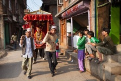 Kumari - Living Goddess is carried in her chariot through the streets of Patan, Nepal - April 10, 2009