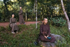Buddhist nuns of Tu Hieu monastery relax after early morning walking meditation in Hue, Vietnam - September 27, 2016