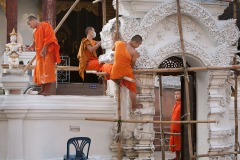 monks paint the wall at Wat Chang Taem monastery, Chiang Mai, Thailand - October 24, 2016