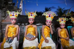 dancers wait for a performance during a temple festival in the village of Ketewel, Bali, Indonesia on May 26, 2015