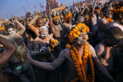 Indian holy men - sadhus photographed during Maha Kumbh Mela pilgrimage in Allahabad, February 10, 2013. Kumbh Mela is a mass Hindu pilgrimage of faith in which Hindus gather to bathe in a sacred river. It is considered to be the largest peaceful gathering in the world.